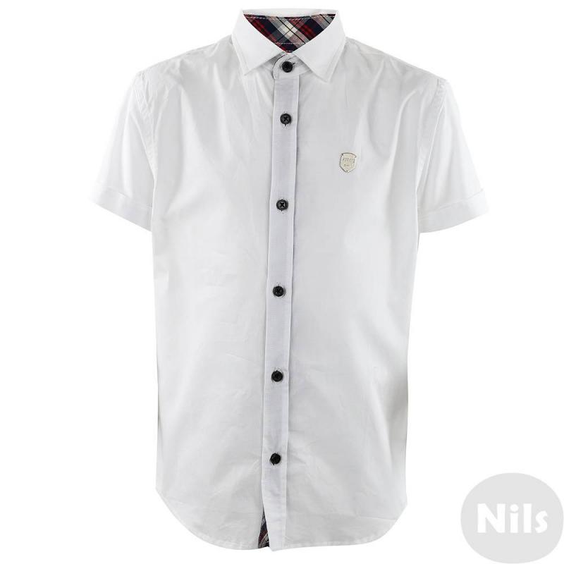РубашкаОднотонная белая рубашка для мальчиков Antony Morato. Классическая рубашка прямого покроя с отложным воротником и коротким рукавом. Пуговицы черного цвета, отделка рубашки из ткани в клетку. Спередифирменная металлическая эмблема.<br><br>Размер: 7 лет<br>Цвет: Белый<br>Рост: 122<br>Пол: Для мальчика<br>Артикул: 611843<br>Страна производитель: Китай<br>Сезон: Весна/Лето<br>Состав: 100% Хлопок<br>Бренд: Италия<br>Вид застежки: Пуговицы<br>Рукава: Короткие