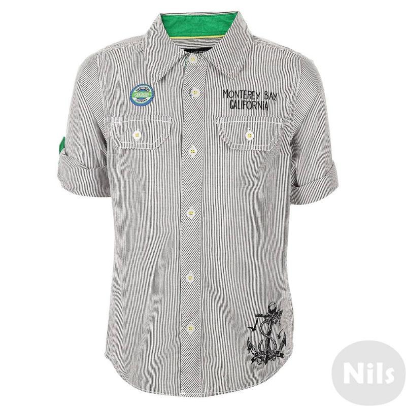 РубашкаРубашка в темно-синюю полоску марки Blue Seven для мальчиков. Хлопковая рубашка с длинным рукавом украшена двумя декоративными карманами на груди, нашивкой, а также принтами в морском стиле на груди и на спине. Отделка выполнена из ткани зеленого цвета. Рукава можно подворачивать (есть специальные пуговицы и петли для отворотов).<br><br>Размер: 3 года<br>Цвет: Темносиний<br>Рост: 98<br>Пол: Для мальчика<br>Артикул: 613099<br>Бренд: Германия<br>Страна производитель: Индия<br>Сезон: Весна/Лето<br>Состав: 100% Хлопок<br>Вид застежки: Пуговицы