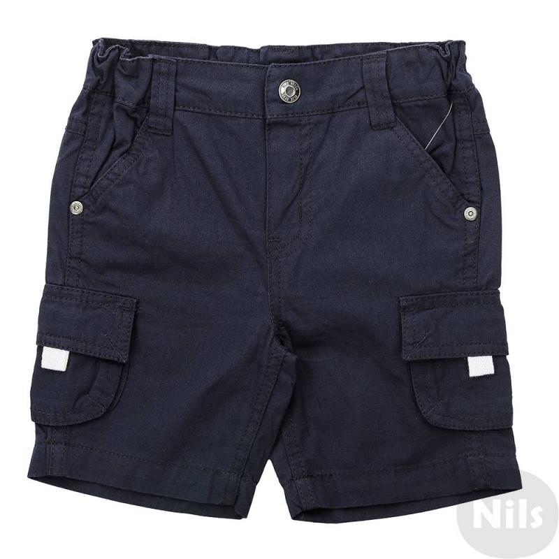 ШортыШорты темно-синего цвета марки Blue Seven для мальчиков. Летние шорты выполнены из чистого хлопка, застегиваются на кнопку. Есть два кармана спереди, а также два накладных кармана на штанинах по бокам. Пояс на резинке регулируется специальными пуговицами на внутренней стороне.<br><br>Размер: 12 месяцев<br>Цвет: Темносиний<br>Рост: 80<br>Пол: Для мальчика<br>Артикул: 612514<br>Страна производитель: Бангладеш<br>Сезон: Весна/Лето<br>Состав: 100% Хлопок<br>Бренд: Германия