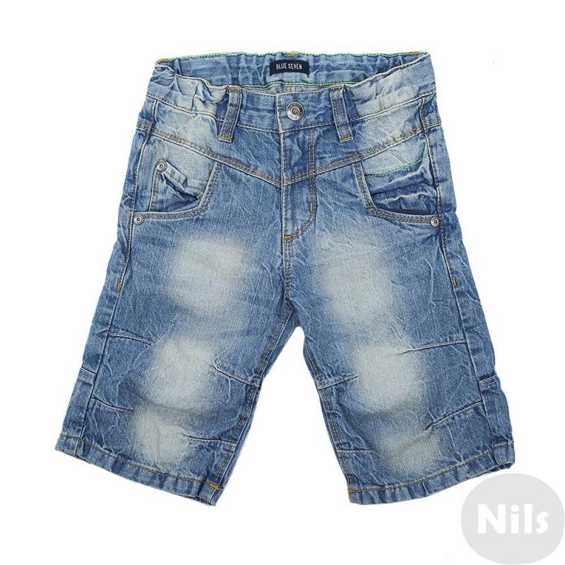 ШортыСиние джинсовые шорты марки Blue Seven для мальчиков. Шорты с пятью карманами выполнены из денима с эффектом потертости, застегиваются на молнию и брючную застежку-крючок. Благодаря специальным вытачкам на коленях шорты не стесняют движений. Пояс на резинке регулируется специальными пуговицами на внутренней стороне. Шорты декорированы зеленой молнией на заднем кармане.<br><br>Размер: 5 лет<br>Цвет: Синий<br>Рост: 110<br>Пол: Для мальчика<br>Артикул: 612884<br>Страна производитель: Бангладеш<br>Сезон: Весна/Лето<br>Состав: 100% Хлопок<br>Бренд: Германия