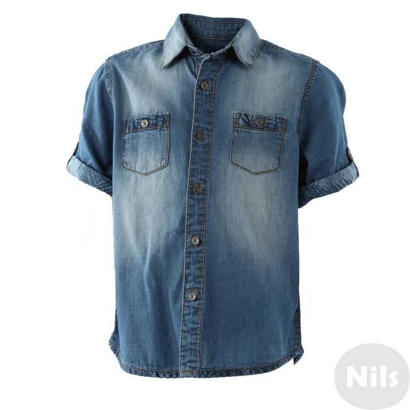 РубашкаДжинсовая рубашка синего цвета марки Mayoral для мальчиков. Рубашка с коротким рукавом выполнена из хлопка, застегивается на пуговицы. На груди два накладных кармана. Рубашка декорирована стильным принтом на спинке, отвороты рукавов и карманы отделаны тканью с принтом.<br><br>Размер: 4 года<br>Цвет: Синий<br>Рост: 104<br>Пол: Для мальчика<br>Артикул: 613980<br>Бренд: Испания<br>Страна производитель: Бангладеш<br>Сезон: Весна/Лето<br>Состав: 100% Хлопок<br>Вид застежки: Пуговицы