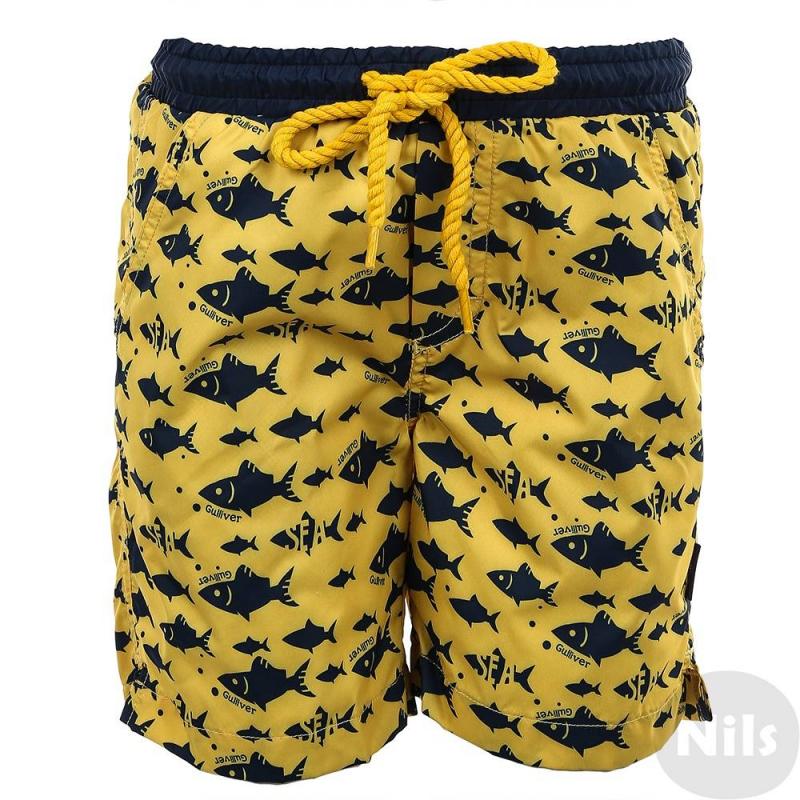 ШортыШорты желтого цвета марки Gulliver для девочек. Купальные шорты украшены принтом с изображением рыбок, выполнены из стопроцентного полиэстера, быстро сохнут. Дополнены подкладкой из дышащей сетки. Шорты имеют два кармана, пояс на резинке дополнительно завязывается на шнурок.<br><br>Размер: 7 лет<br>Цвет: Желтый<br>Рост: 122<br>Пол: Для мальчика<br>Артикул: 627165<br>Страна производитель: Китай<br>Сезон: Весна/Лето<br>Состав: 100% Полиэстер<br>Состав подкладки: 100% Полиэстер<br>Бренд: Россия