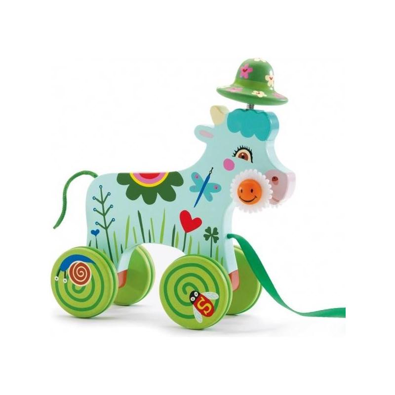 Игрушка-каталка Корова - DjecoКаталка Корова марки Djeco.Эта милаякорова-каталка обязательно понравится вашему ребенку. Ведь ее можно катать за собой где угодно – и дома, и на прогулке. Игрушка подходит для детей от 2 лет.Французская компания Djeco уже много лет производит развивающие игрушки специально для малышей. С помощью квалифицированных психологов и педиатров игрушки создаются такими, чтобы они нравились детям. Милаякоровкасделана из натуральныхматериалов, окрашена нетоксичными красками. Поэтому игрушка абсолютно безопасна даже для самых маленьких детей. Играя с этой каталкой, ребенок будет развивать мелкую моторику, координацию движений и цветовое восприятие.<br><br>Возраст от: 2 года<br>Пол: Не указан<br>Артикул: 634671<br>Бренд: Франция<br>Размер: от 2 лет<br>Материал: Дерево