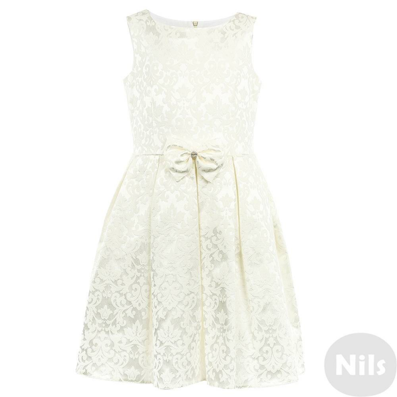 ПлатьеПлатьемолочно-белогоцвета марки Fansy Way.<br>Праздничное жаккардовое платье на широких бретеляхимеет пышнуюплиссированную юбку, дополнено подъюбником из фатина и хлопковой подкладкой. Платьедекорировано витиеватым узором и элегантным бантом. Платье застегивается на потайную молнию и шнуровку на спинке.<br>Нарядное платье Fansy Wayстанет самым изысканным нарядом на любом празднике.<br><br>Размер: 6 лет<br>Цвет: Белый<br>Рост: 116<br>Пол: Для девочки<br>Артикул: 647742<br>Страна производитель: Россия<br>Сезон: Всесезонный<br>Состав: 60% Хлопок, 25% Полиамид, 15% Эластан<br>Бренд: Россия<br>Вид застежки: Молния