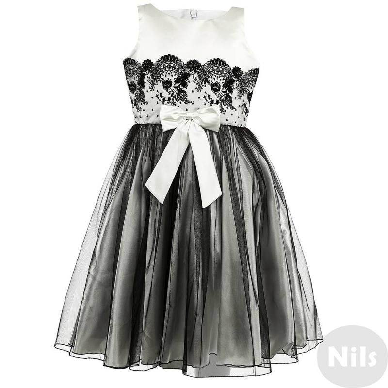 ПлатьеПлатьечерно-белогоцвета марки Fansy Way для девочек.<br>Праздничное платье с пышной многослойной юбкой выполнено из тонкого полупрозрачного фатиначерного цветаиатласа белого цвета, дополнено подъюбником и хлопковой подкладкой. Топ платья украшен кружевом черного цвета, пояс декорирован большим атласным бантом. Застегивается платье на молнию и шнуровку на спине.<br>Нарядное платье Fansy Wayстанет самым изысканным нарядом на праздничном мероприятии.<br><br>Размер: 8 лет<br>Цвет: Белый<br>Рост: 128<br>Пол: Для девочки<br>Артикул: 634322<br>Страна производитель: Россия<br>Сезон: Всесезонный<br>Состав верха: 100% Полиэстер<br>Состав подкладки: 100% Хлопок<br>Бренд: Россия<br>Вид застежки: Молния