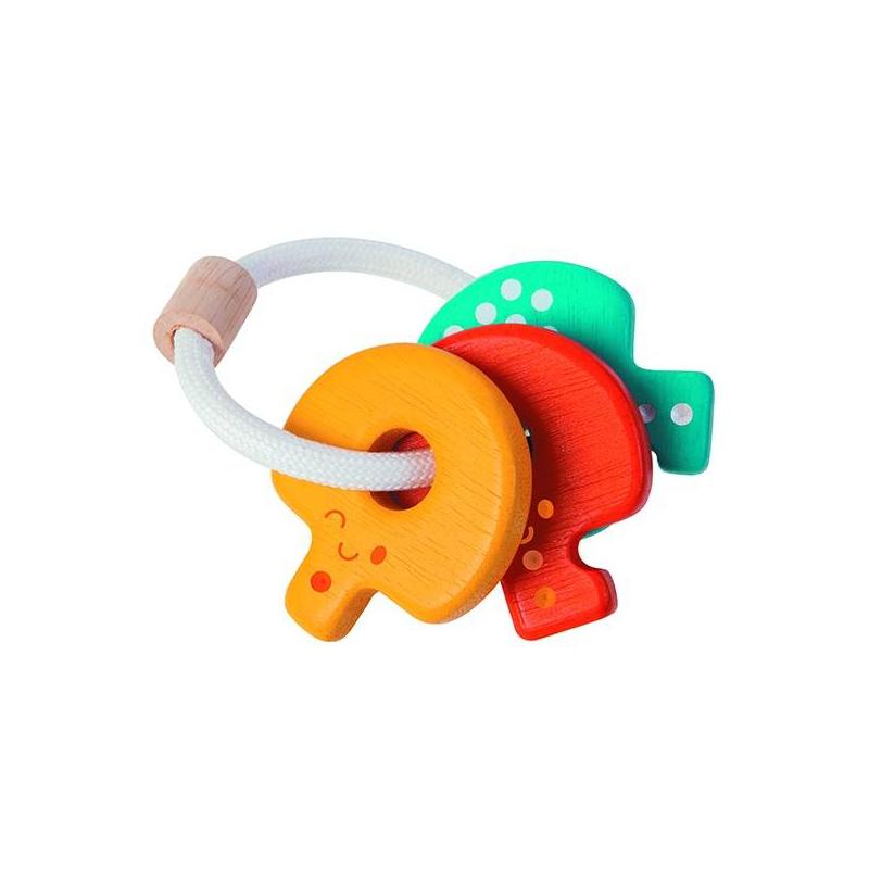 Погремушка КлючиПогремушка Ключи маркиPlan Toys.<br>Таиландская фирма Plan Toys производит качественные игрушки, которые не только способствуют быстрому и гармоничному развитию ребенка, но и доставляют ему много радости. Все игрушки Plan Toys производятся из качественных нетоксичных материалов, безопасных для ребенка.<br>Погремушкасделана из каучукового дерева. Она очень гладкая, без острых углов. Малышу будет удобно держать ее самому, ведь она хорошо ложится в маленькую детскую ручку.<br><br>Возраст от: 3 месяца<br>Пол: Не указан<br>Артикул: 634687<br>Бренд: Таиланд<br>Размер: от 3 месяцев<br>Материал: Дерево