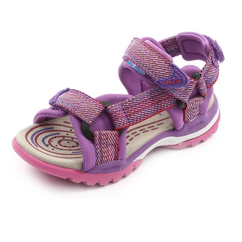 СандалииСандалии фиолетовогоцвета марки GEOX для девочек.<br>Сандалии на липучкахдекорированы краснымивставками.Сандалии изготовлены из водооталкивающего материала. Обувь может использоваться как в пресной, так и в соленой воде.<br>Нескользящая подошва сводооталкивающеймембраной хорошо дышит, что предотвращает перегревание стопы и сохраняет ножки сухими.Помимо этого модель дополнена кожаной ударопрочной стелькой.<br><br>Размер: 29<br>Цвет: Фиолетовый<br>Пол: Для девочки<br>Артикул: 642419<br>Страна производитель: Вьетнам<br>Сезон: Весна/Лето<br>Материал верха: Текстиль<br>Материал подкладки: Текстиль<br>Материал стельки: Натуральная кожа<br>Материал подошвы: Резина<br>Бренд: Италия