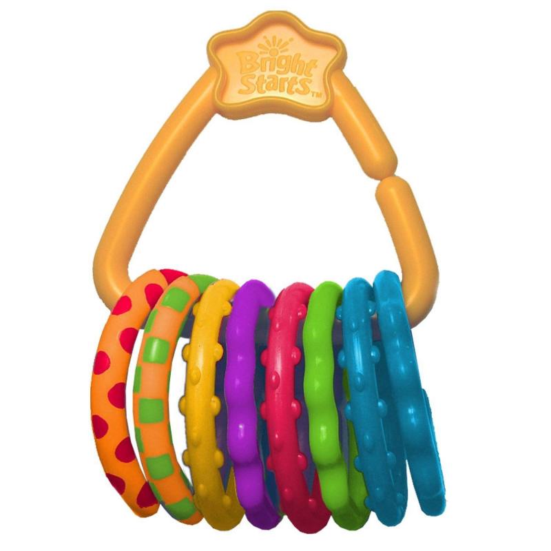 Прорезыватель Веселые колечкиПрорезыватель Веселые колечки марки Bright Starts.<br>Развивающая текстурная игрушка-прорезыватель помогает снять боль в период роста зубов. Погремушка выполнена из гипоаллергенного мягкого материала. На оранжевом держателе треугольной формы со звёздочкой расположено 8 мягких разноцветных колец.<br>Модель 2 в 1: одновременно игрушка и прорезыватель. Он не только успокоит десна, но и развлечет малыша, когда он будет перебирать колечки. Удобная игрушка с милым дизайном, которую можно прикреплять к коляске, развивающему коврику или переноске.<br><br>Возраст от: 0 месяцев<br>Пол: Не указан<br>Артикул: 653213<br>Бренд: США<br>Размер: от 0 месяцев