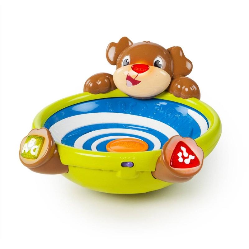Развивающая игрушка Игривый щенокРазвивающая игрушка Игривый щенок марки Bright Starts.<br>Игрушка в виде забавного щенка с тремя разноцветными шариками, которые бегают по кругу и вылетают из чаши. Задача малыша - их поймать и снова начать игру. Нос щенка светится во время игры, цветные фигурные кнопочки нужны для изучения цветов, фигур, букв или прослушивания мелодии. Слова и песенки на английском, испанском и французском языках.<br><br>Возраст от: 6 месяцев<br>Пол: Не указан<br>Артикул: 653236<br>Бренд: США<br>Размер: от 6 месяцев