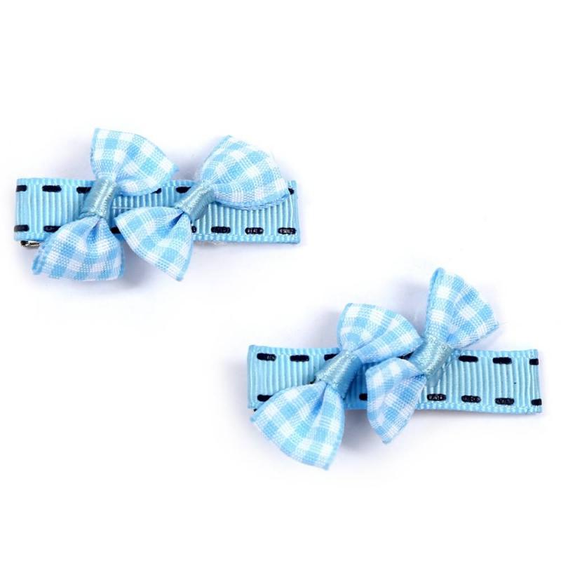 Комплект заколокКомплект заколок2 шт. голубогоцвета марки Arco Carino.<br>Комплект состоит из двух заколок с застежкой пеликан, украшенных бантиками и лентами с имитацией контрастной строчки.Стильные заколкивыгодно подчеркнут любую прическу.<br>Размеродной заколки: 5см.<br><br>Цвет: Голубой<br>Пол: Для девочки<br>Артикул: 647824<br>Страна производитель: Россия<br>Бренд: Россия<br>Размер: Без размера