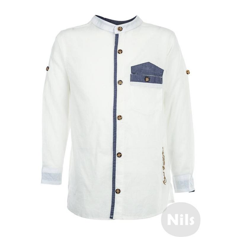 РубашкаБелая рубашка марки NANICA для мальчиков. Рубашка с воротничком-стойкой и нагрудным кармашком выполнена из тонкого стопроцентного хлопка. Рубашка украшена контрастной отделкой голубого цвета. Длинные рукава можно подворачивать. Рубашка застегивается на пуговицы.<br><br>Размер: 5 лет<br>Цвет: Белый<br>Рост: 110<br>Пол: Для мальчика<br>Артикул: 606011<br>Страна производитель: Турция<br>Сезон: Весна/Лето<br>Состав: 100% Хлопок<br>Бренд: Турция