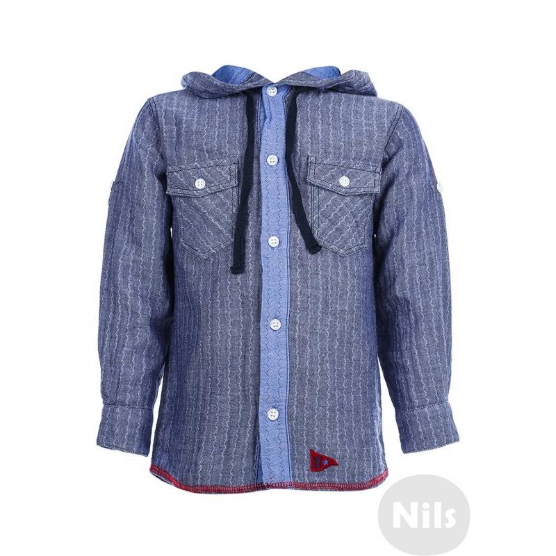 РубашкаРубашка голубогоцвета с капюшоном марки NANICA для мальчиков. Рубашка с двумя нагрудными карманами и капюшоном выполнена из стопроцентного мягкого хлопка и застегивается на пуговицы, на локтях декоративные заплатки. Рукава можно красиво подворачивать.<br><br>Размер: 7 лет<br>Цвет: Голубой<br>Рост: 122<br>Пол: Для мальчика<br>Артикул: 606067<br>Страна производитель: Турция<br>Сезон: Всесезонный<br>Состав: 100% Хлопок<br>Бренд: Турция