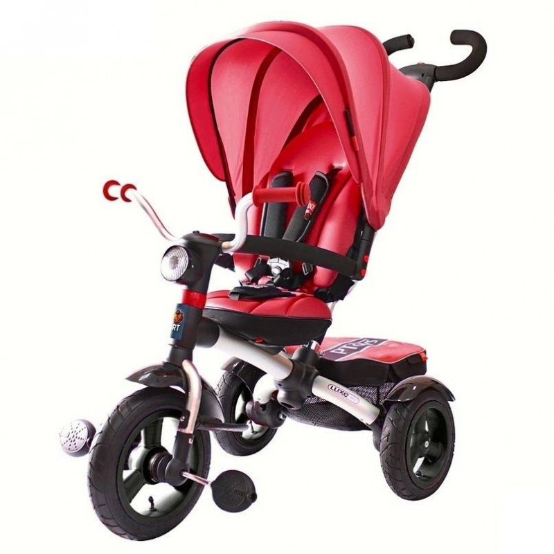 """Велосипед-коляска трехколесный Luxe AluminiumВелосипед-коляска трехколесный Luxe Aluminium малинового цвета марки ICON.<br>Алюминиевый трехколесный велосипед-коляска с подножками-крыльями. Облегченная модель ICON - рама, родительская ручка и вилка из алюминия. Большие надувные колеса, большое сиденье, а также капюшон как у коляски.<br>Съемный капюшон как у коляски закрывает ребенка полностью. Невесомый и большой выполнен из легкой ткани с UV-защитой от солнца. Высокое мягкое сиденье, которое легким движением руки можно наклонить до положения полулежа, повернуть лицом к маме или лицом к дороге. Но в то же время вы сможете использовать этот велосипед до 5 лет.<br>ICON Luxe имеет алюминиевую управляемую ручку Телескопик"""", усиленную и прочную. Высота ручки регулируется в четырех положениях от 81 см до 96 см. Новое качество, которое довели до совершенства: мягкая рукоятка эргономичной формы с помощью кнопки регулируется в любом положении на 360 градусов. Вы сможете настроить ее под себя как Вам захочется. Очень длинная и удобная родительская ручка Телескопик установлена под идеальным углом и подходит под любой рост взрослого.<br>Нижний уровень телескопической ручки настроен таким образом, чтобы любой маленький помощник смог толкать и везти велосипед. Также легко и удобно можно настроить рукоятку ручки. Теперь Вы можете преодолевать бордюры и одновременно поворачивать велосипед направо и налево. Мощный технически продуманный узел на раме теперь позволяет это делать. 5-ти точечные ремни безопасности.<br>Ручка легко вставляется в раму по системе до щелчка"""" и затягивается надежным усиленным эксцентриком. Снять ручку можно легко и просто, нажав красную кнопку внизу. Установить крылья на задние колеса также до щелчка"""". Багажная корзинка также устанавливается до щелчка"""". Сиденье устанавливается на полозья также до щелчка"""" и легко перемещается ближе или дальше от руля.<br>Вы удивитесь, как двигается сиденье по полозьям вперед-назад, легко и непринужденно. Вам достаточно только л"""